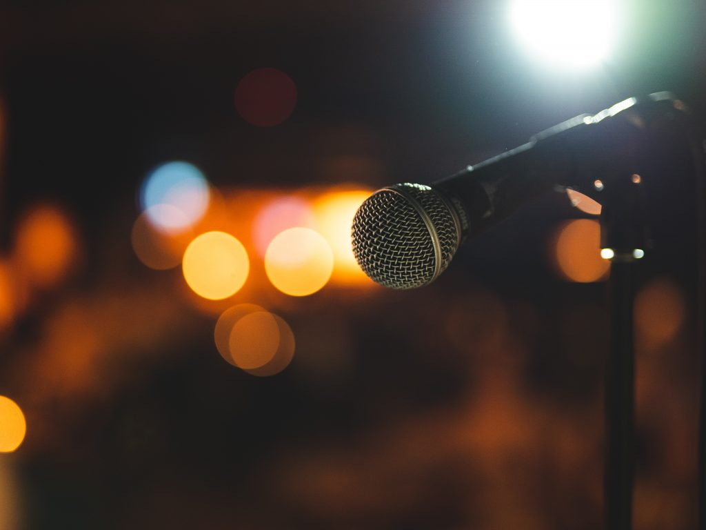 Microphone on a stand with bokeh effect on the background