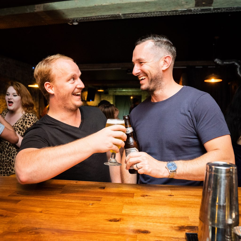 Two men in Soultrap Bar enjoying their drinks
