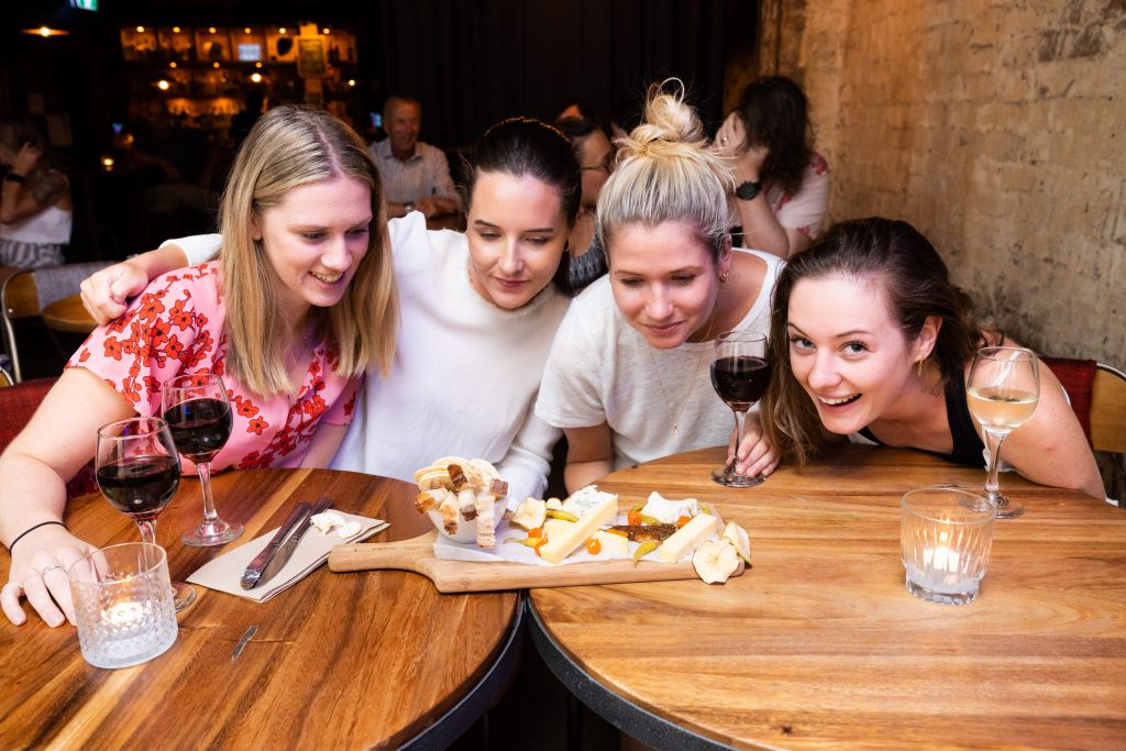 Four girls enjoying their charcuterie grazing board and wine on Soultrap Bar