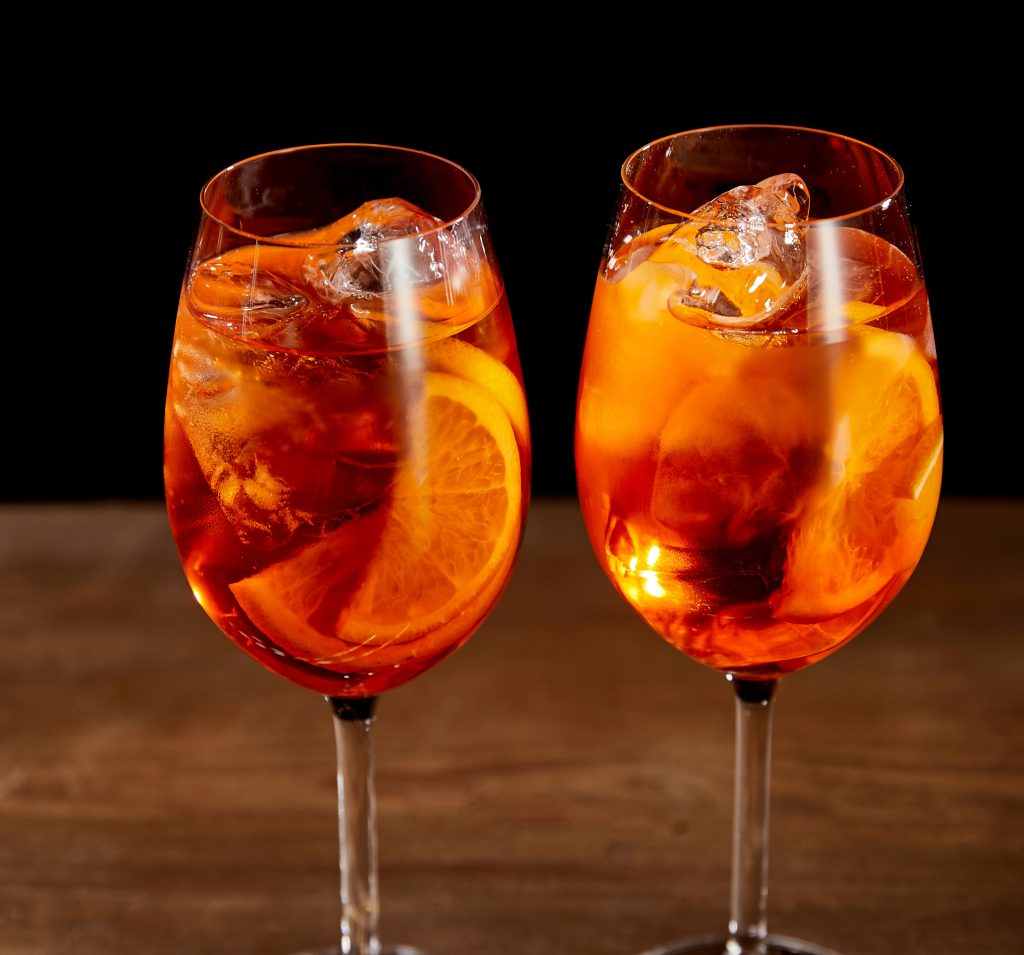 Two glasses of orange cocktail